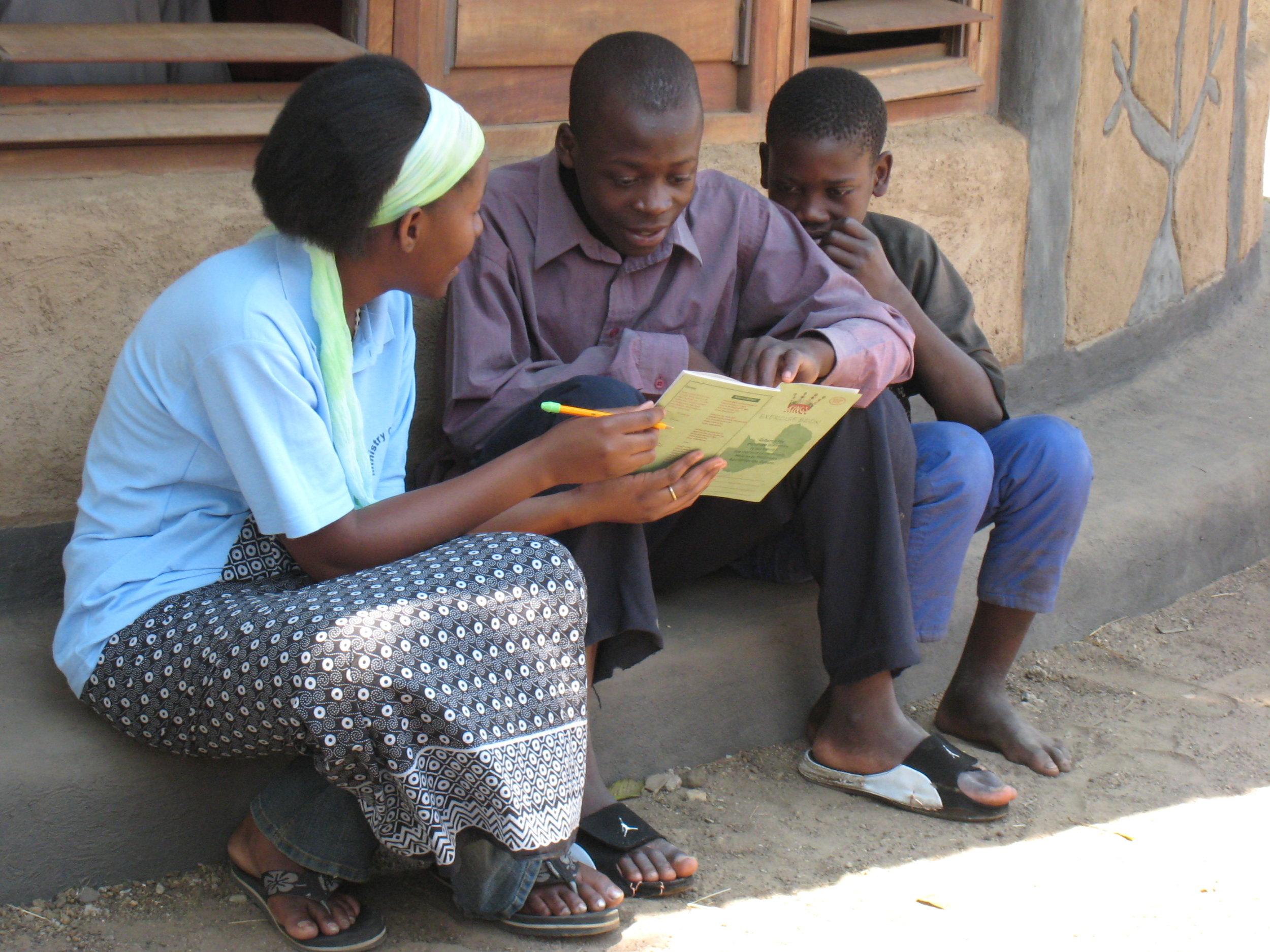 Children Reading outside of Library