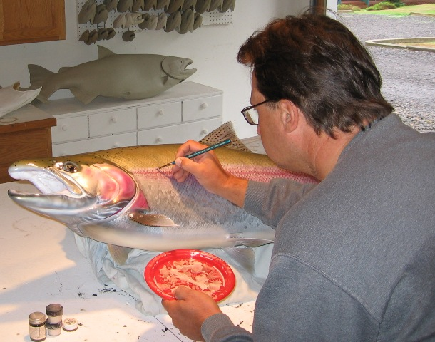 Luke Filmer of Blackwater Fish Replicas hand painting scales on steelhead mount.JPG