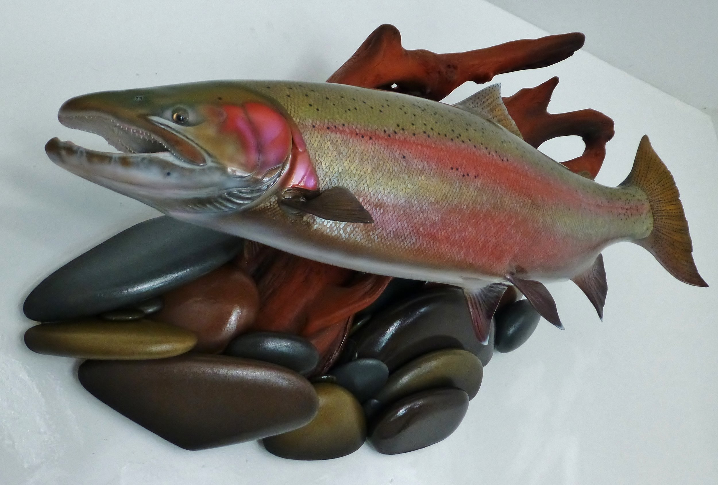 Steelhead fish replica art sculpture on river rock driftwood enhancement by Luke Filmer Blackwater replicas