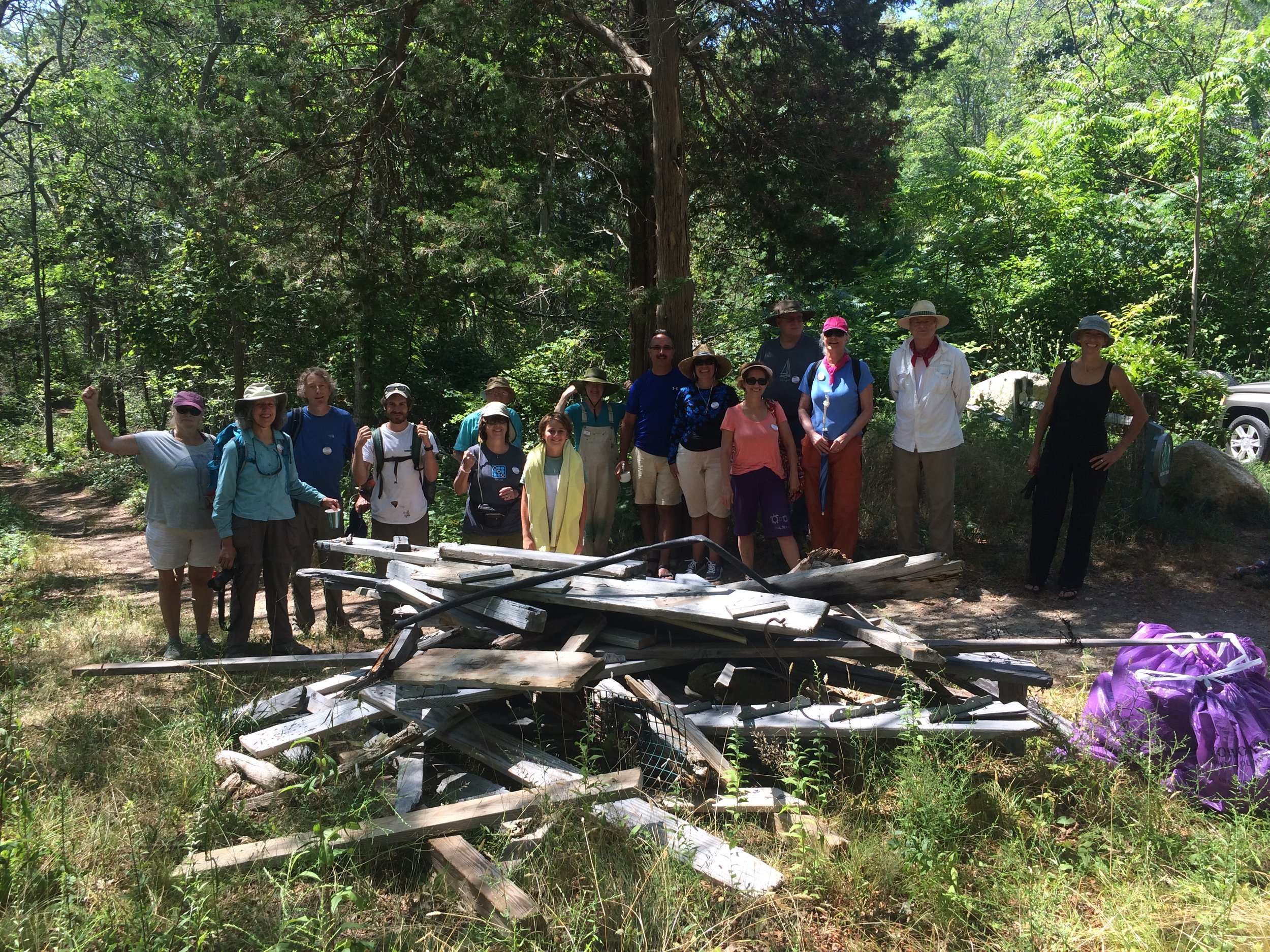 Sierra Club volunteers haul a washed up dock to the Center Hill Preserve trail head.