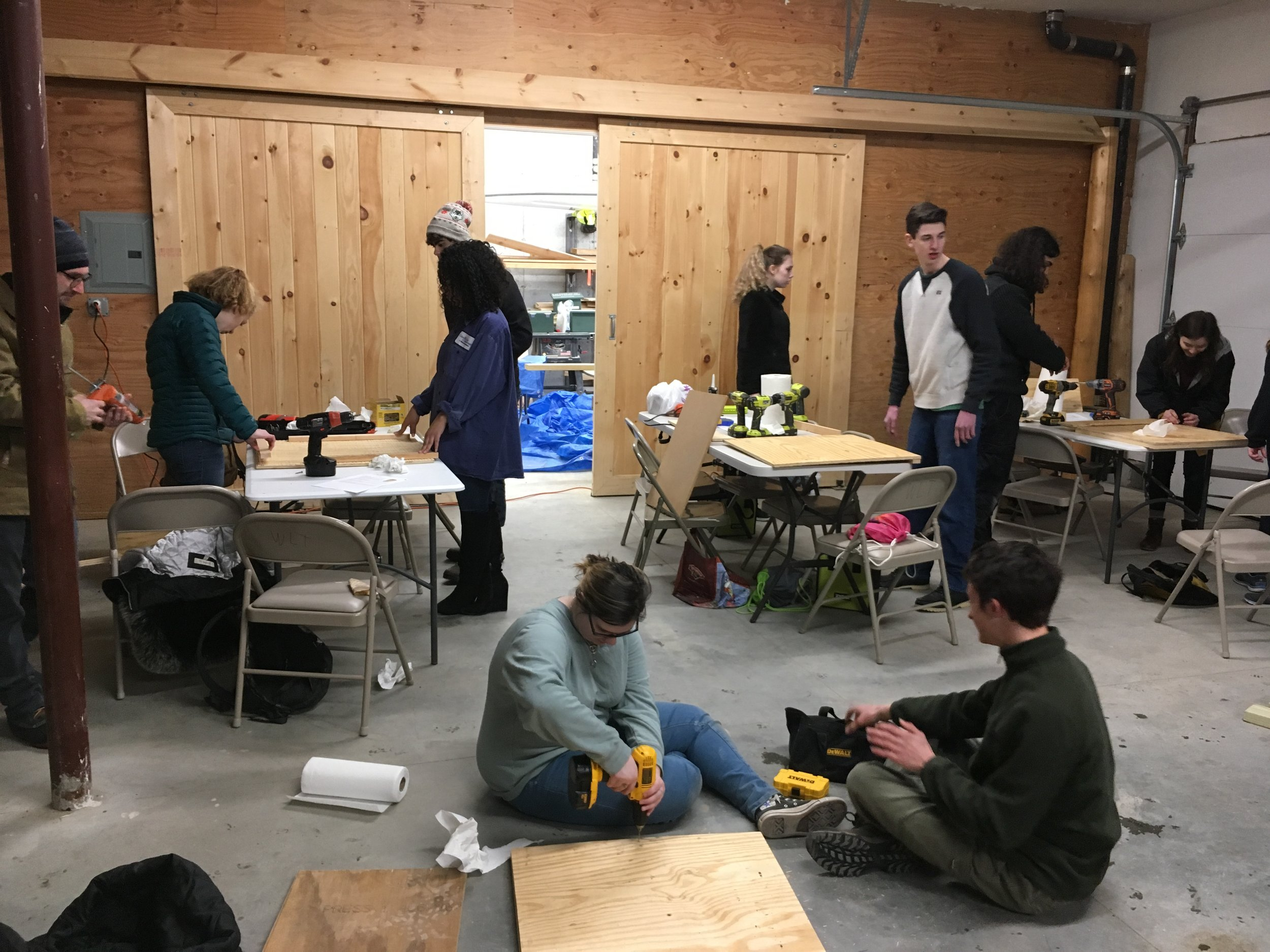 Seniors at Rising Tide build bat homes and benches for Wildlands Trust properties.