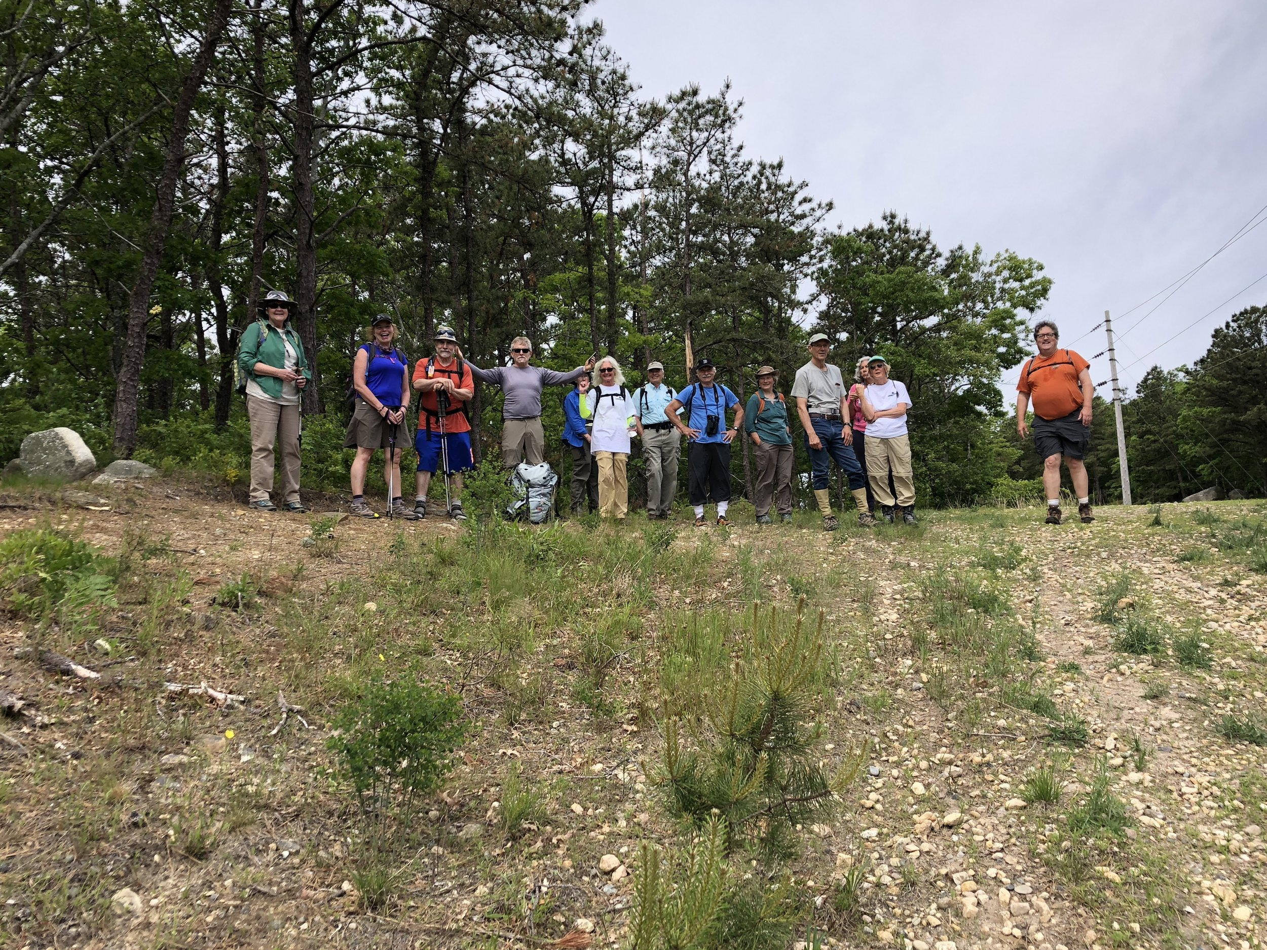 The Day One crew atop the geographic Pine Hills