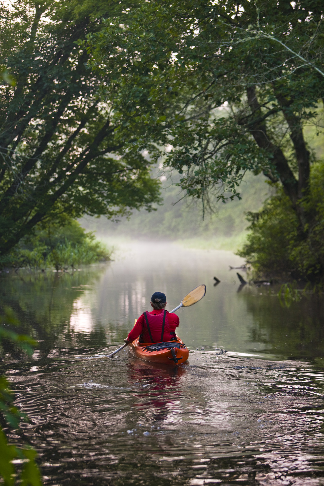A kayaker enjoys a quiet trip down the tranquil waters of Indian Head River.