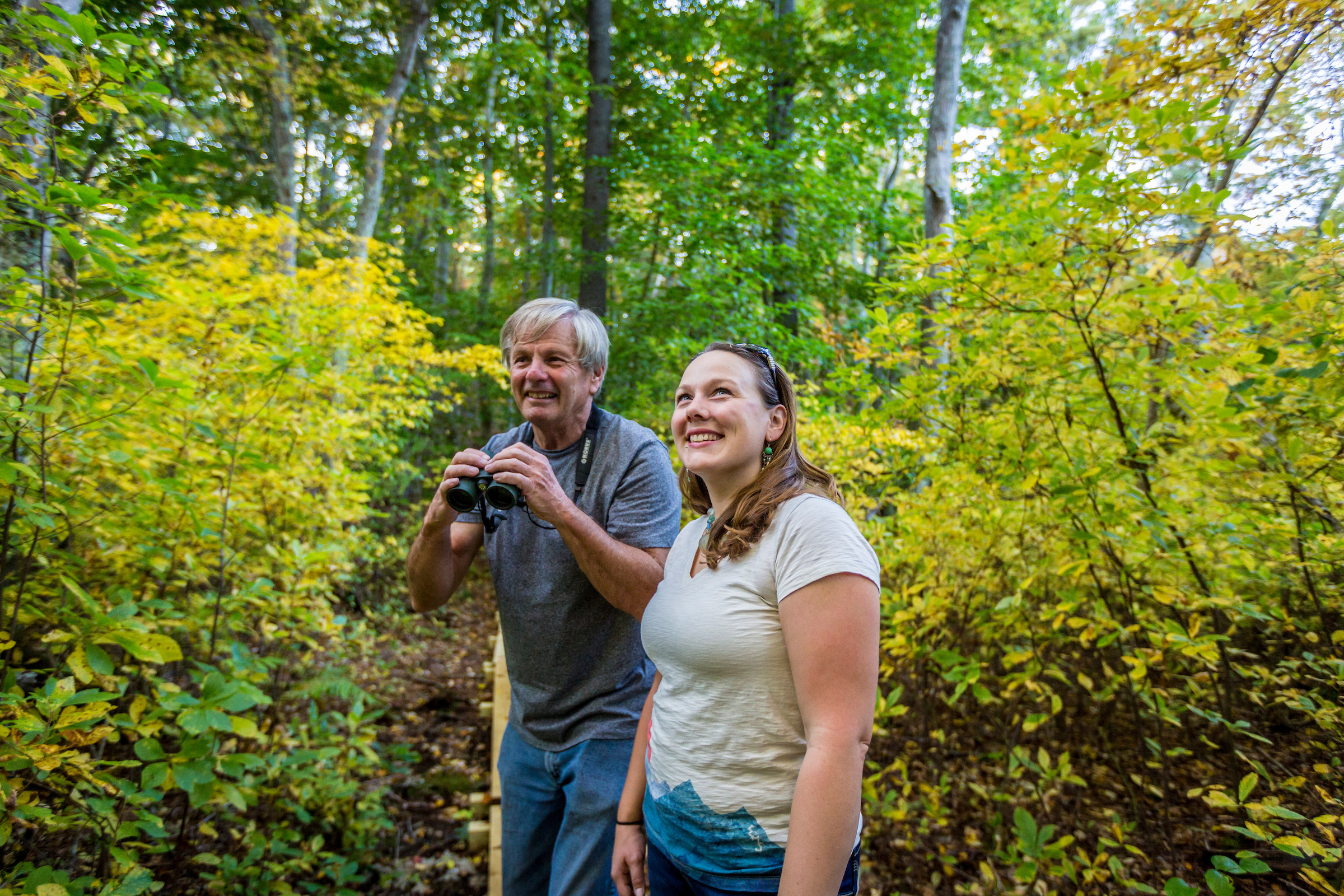 Mike Arsenault and Wildlands' Outreach and Education Manager Rachel Calderara check out the trees at Hoyt-Hall Preserve.