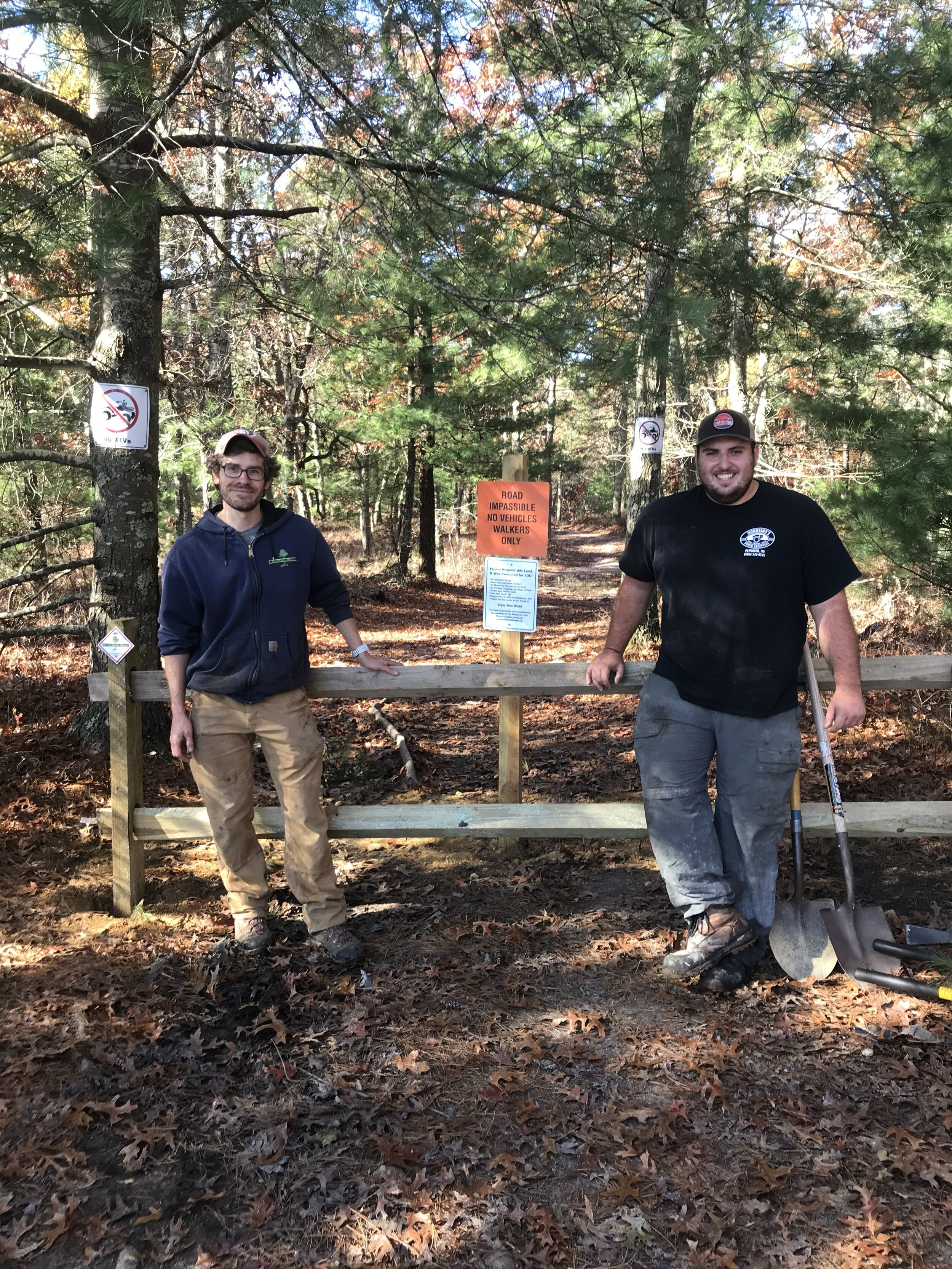 Stewardship Manager Erik Boyer (left) and Land Steward Owen Grey (right) at Muddy Pond Preserve after closing a main ATV entry point.