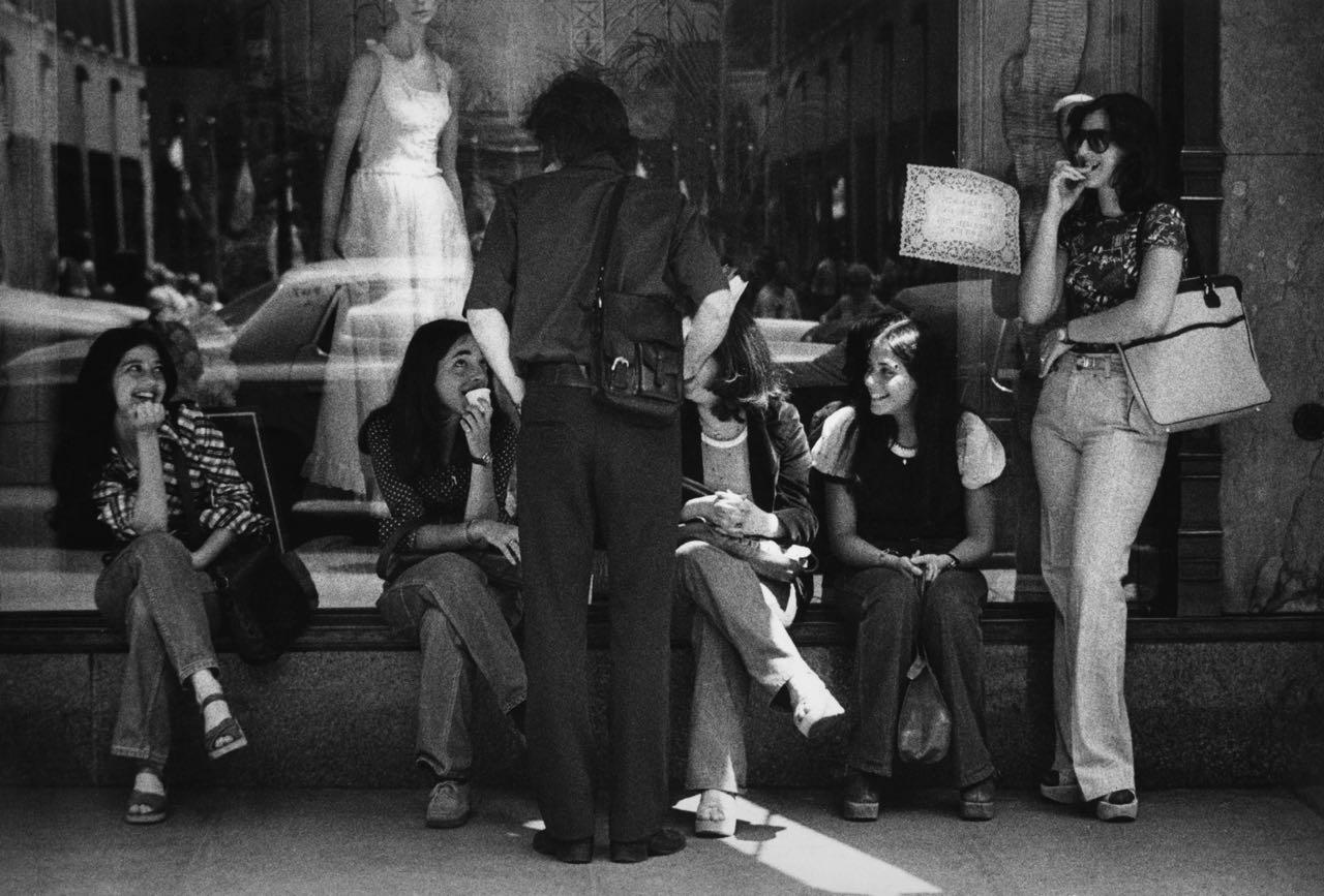 15_32_Women sitting by a store window_Dan Wynn Archive.jpg