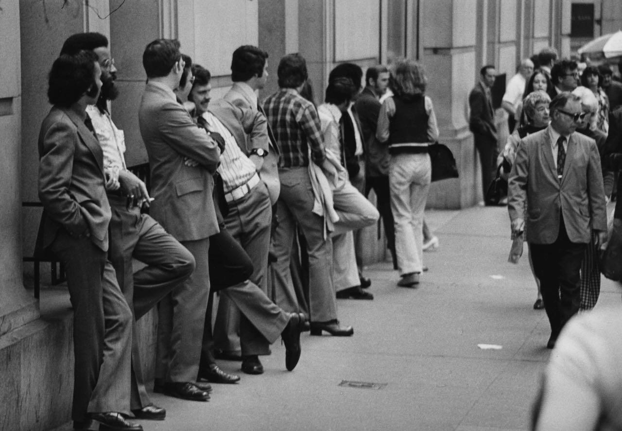 15_36_A group of men waiting in line on the street_Dan Wynn Archive.jpg