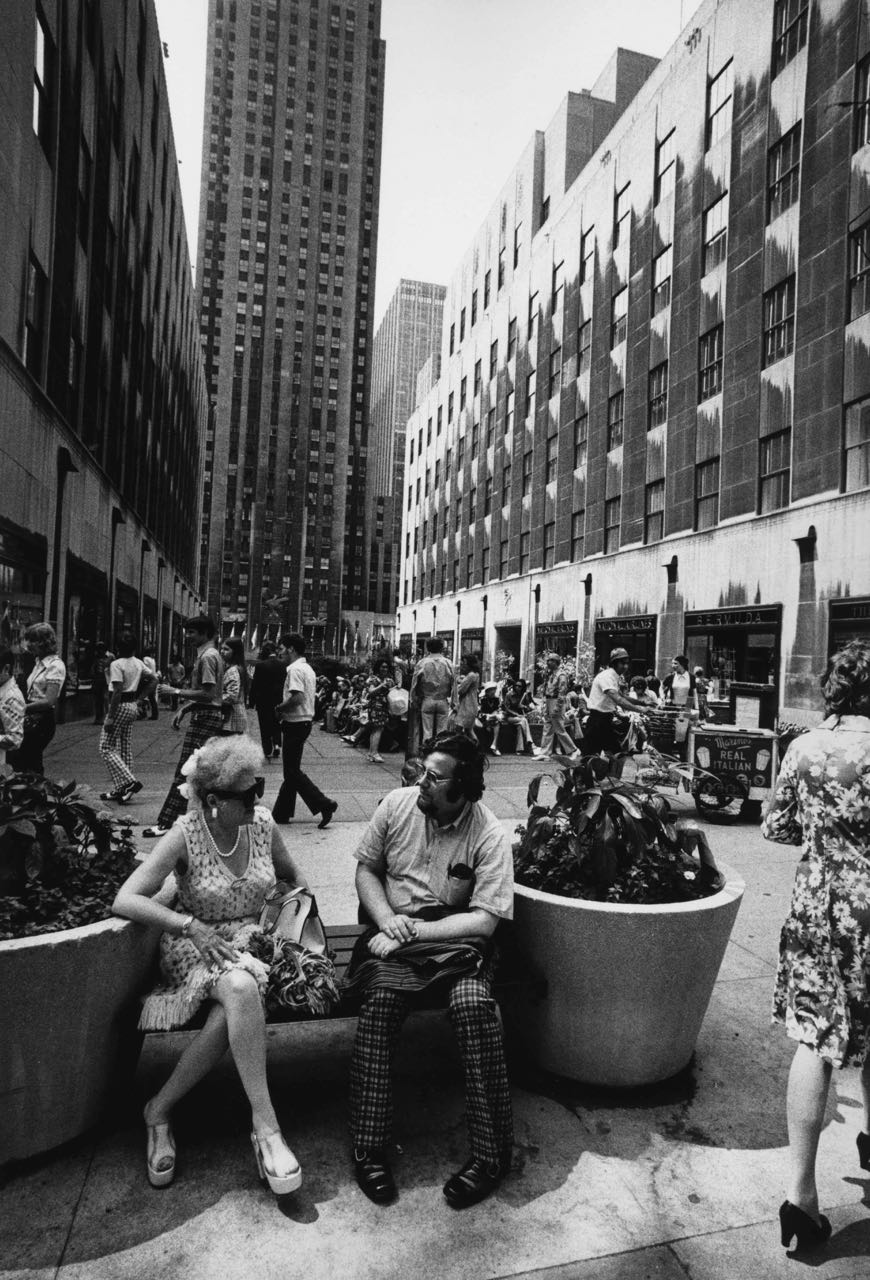 15_42_Man and woman sitting on a bench in busy city square_Dan Wynn Archive.jpg