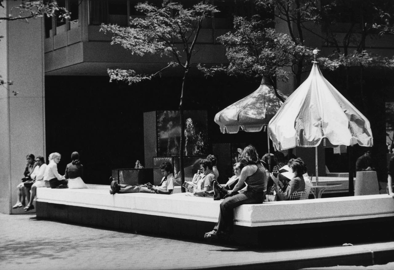 15_53_People lounging aound and reading in outdoor patio_Dan Wynn Archive.jpg