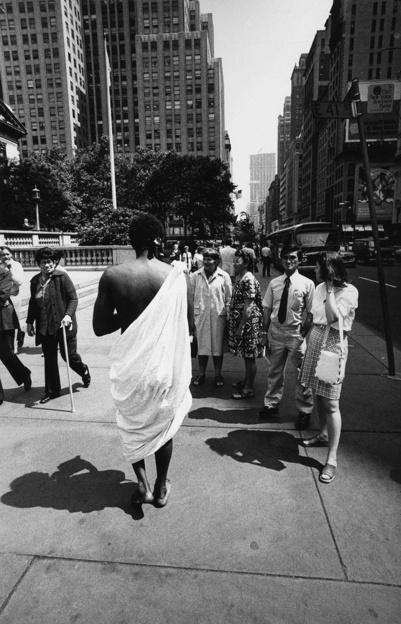 15_61_Man wearing toga walking down the street_Dan Wynn Archive.jpg