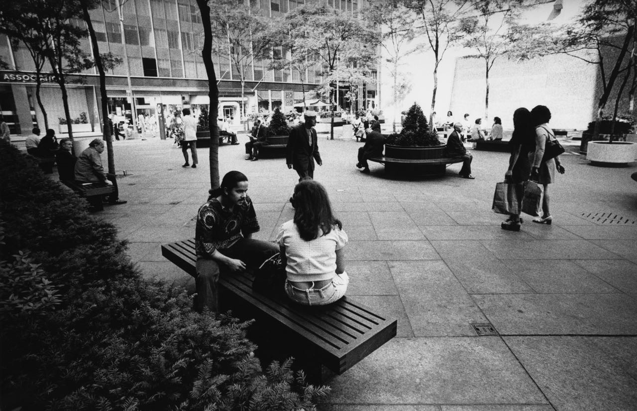 15_68_Man and woman chatting on a bench in a plaza_Dan Wynn Archive.jpg