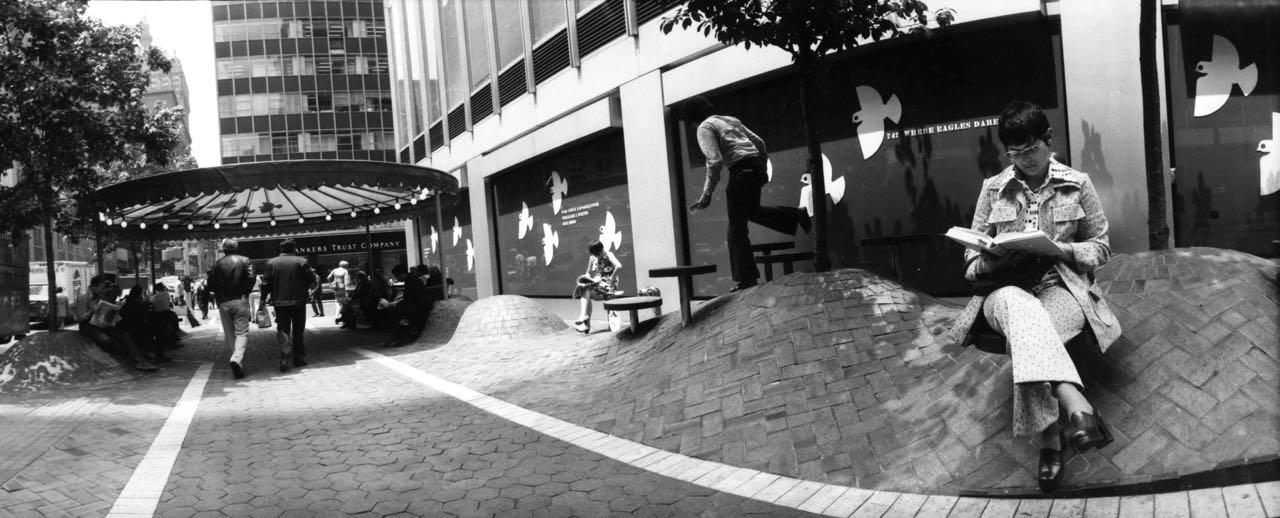 15_69_Woman reading a book on the street_Dan Wynn Archive.jpg