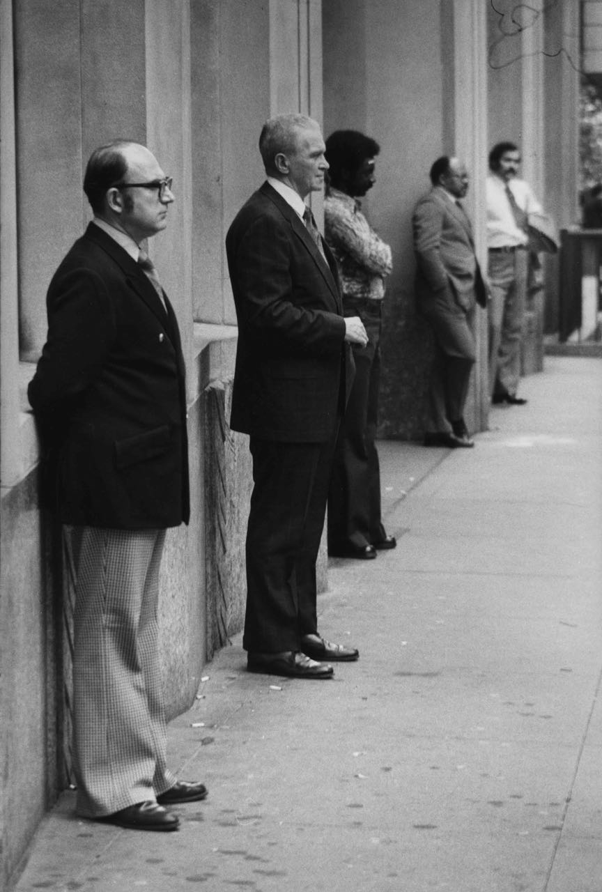 15_71_Business men standing against a building_Dan Wynn Archive.jpg