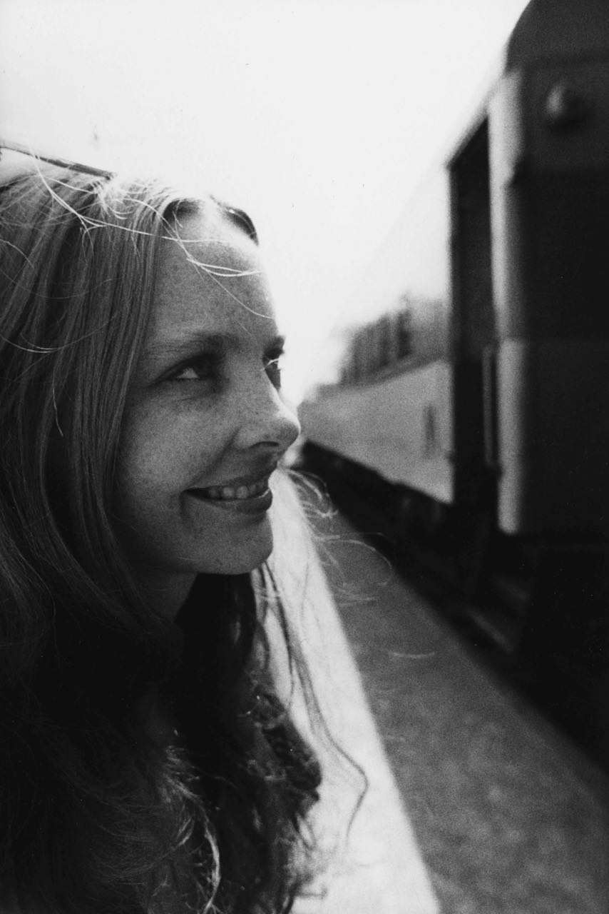 15_6_A young woman looking at a train_Dan Wynn Archive.jpg