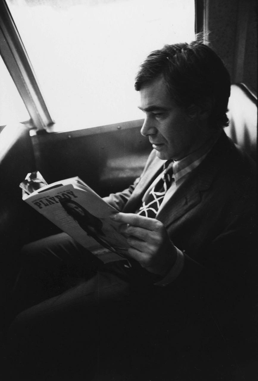 15_7_Man sitting in a train reading Playboy_Dan Wynn Archive.jpg