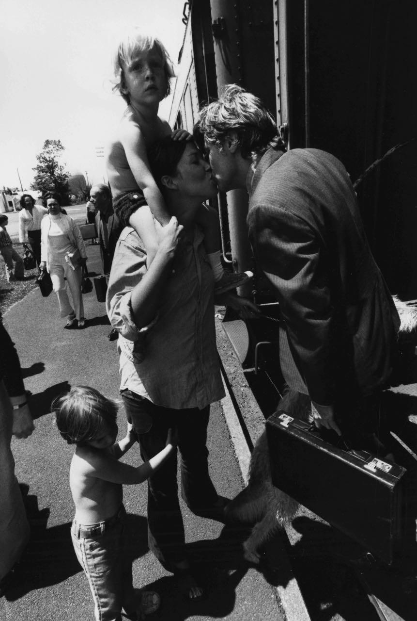 15_14_Wife kissing husband goodbye at a train station_Dan Wynn Archive.jpg
