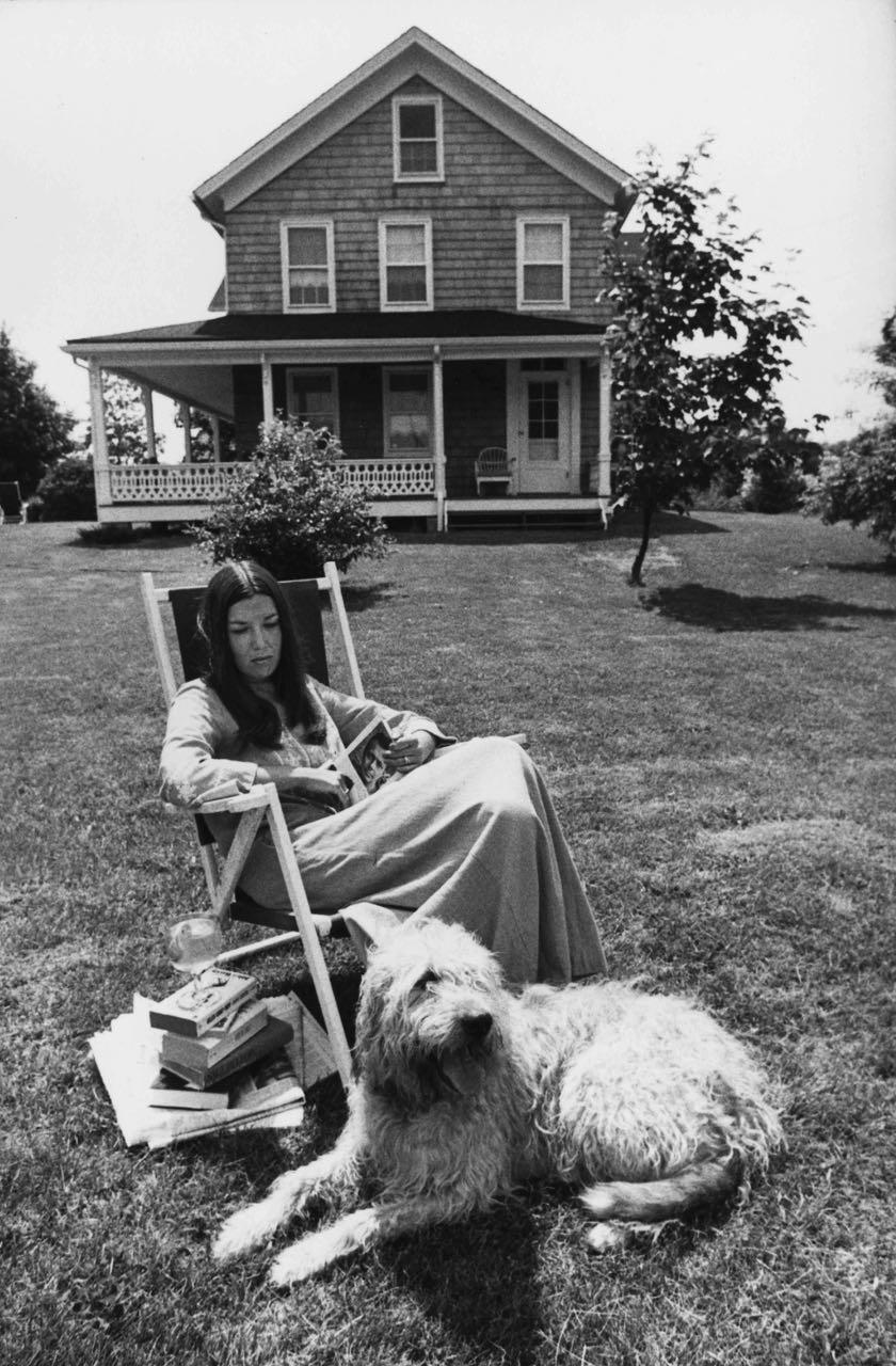 15_17_Woman reading a book in the front lawn #2_Dan Wynn Archive.jpg