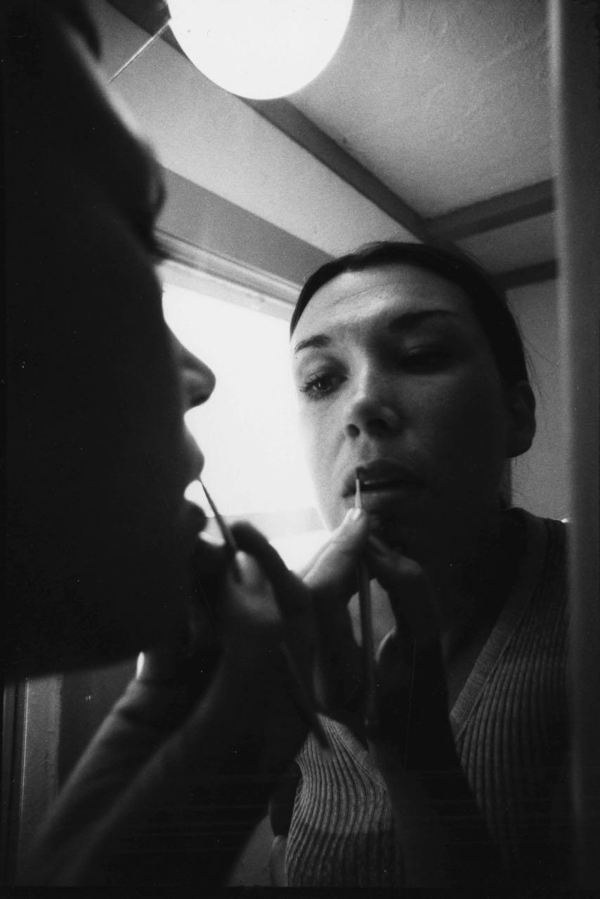 15_22_Woman applying makeup in front of a mirror_Dan Wynn Archive.jpg