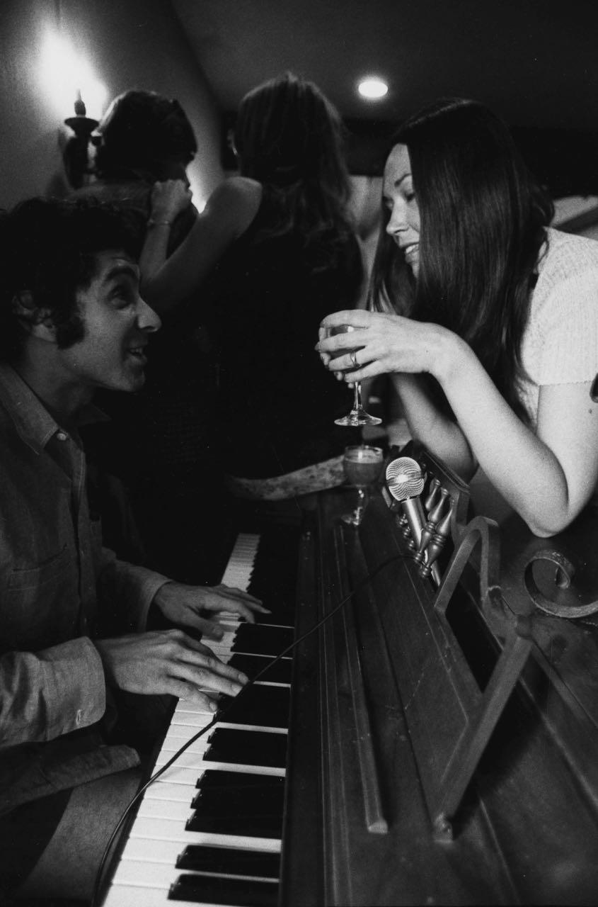 15_21_Woman talking to man over piano #2_Dan Wynn Archive.jpg