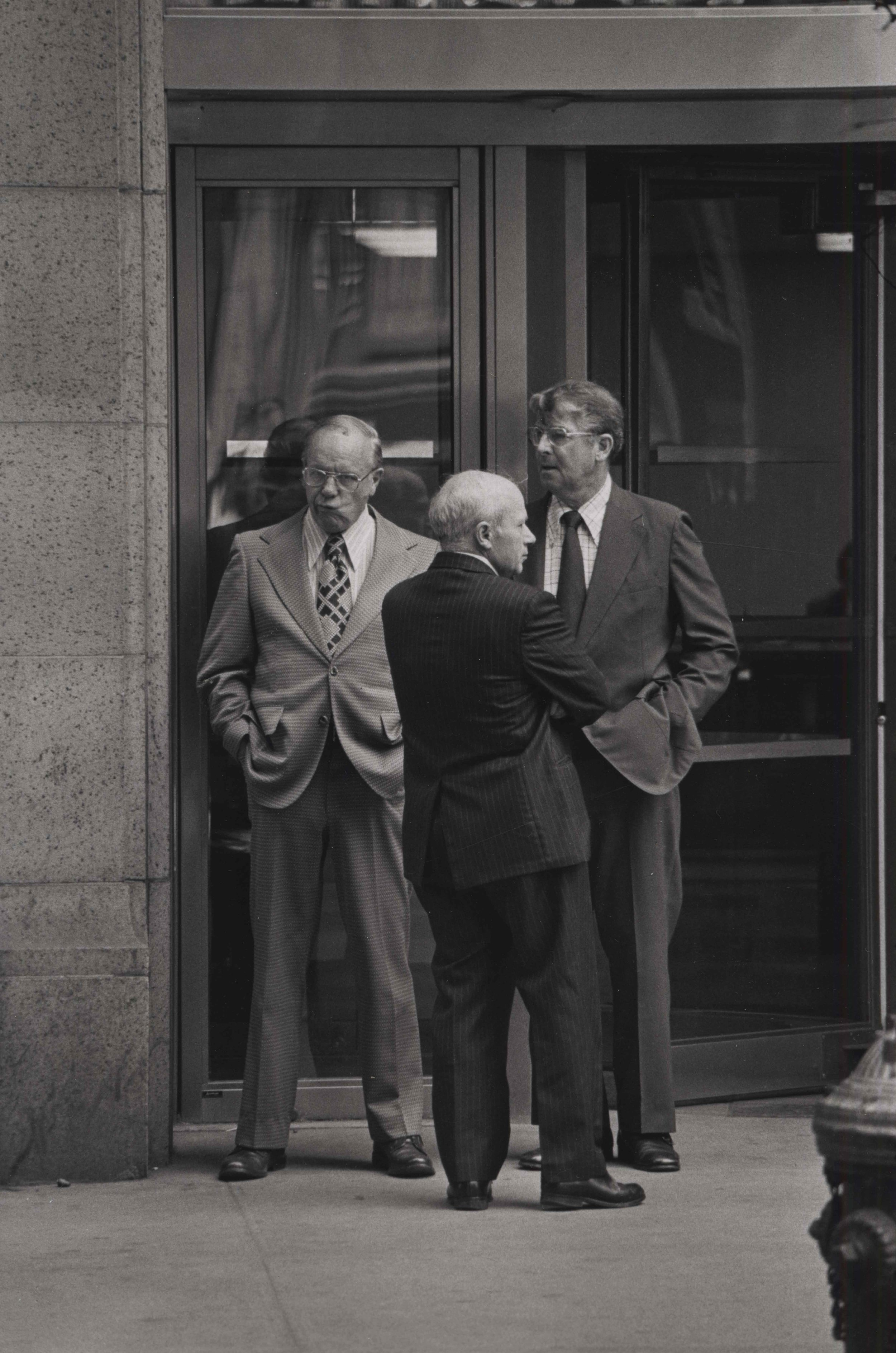 15_85_Three standing men in business suits_Dan Wynn Archive.jpeg