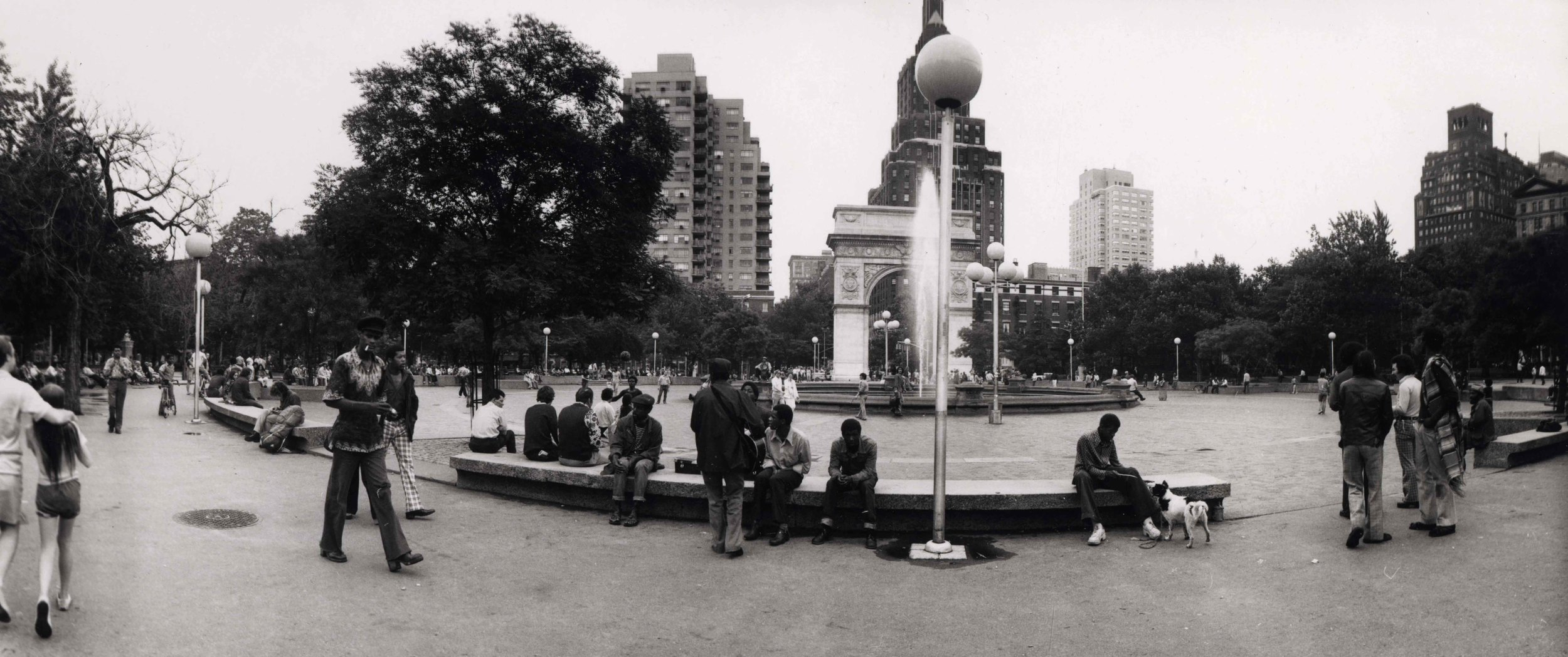 15_89_People hanging out in a park with trees and fountain_Dan Wynn Archive.jpeg