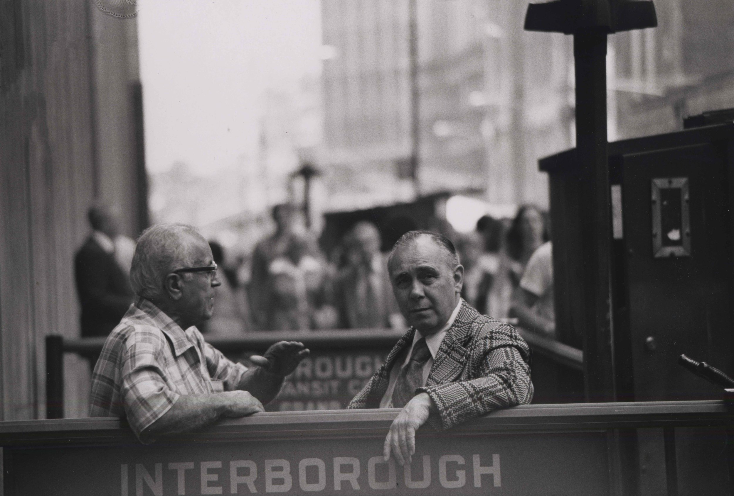 15_92_Two men conversing while looking over a fence_Dan Wynn Archive.jpeg