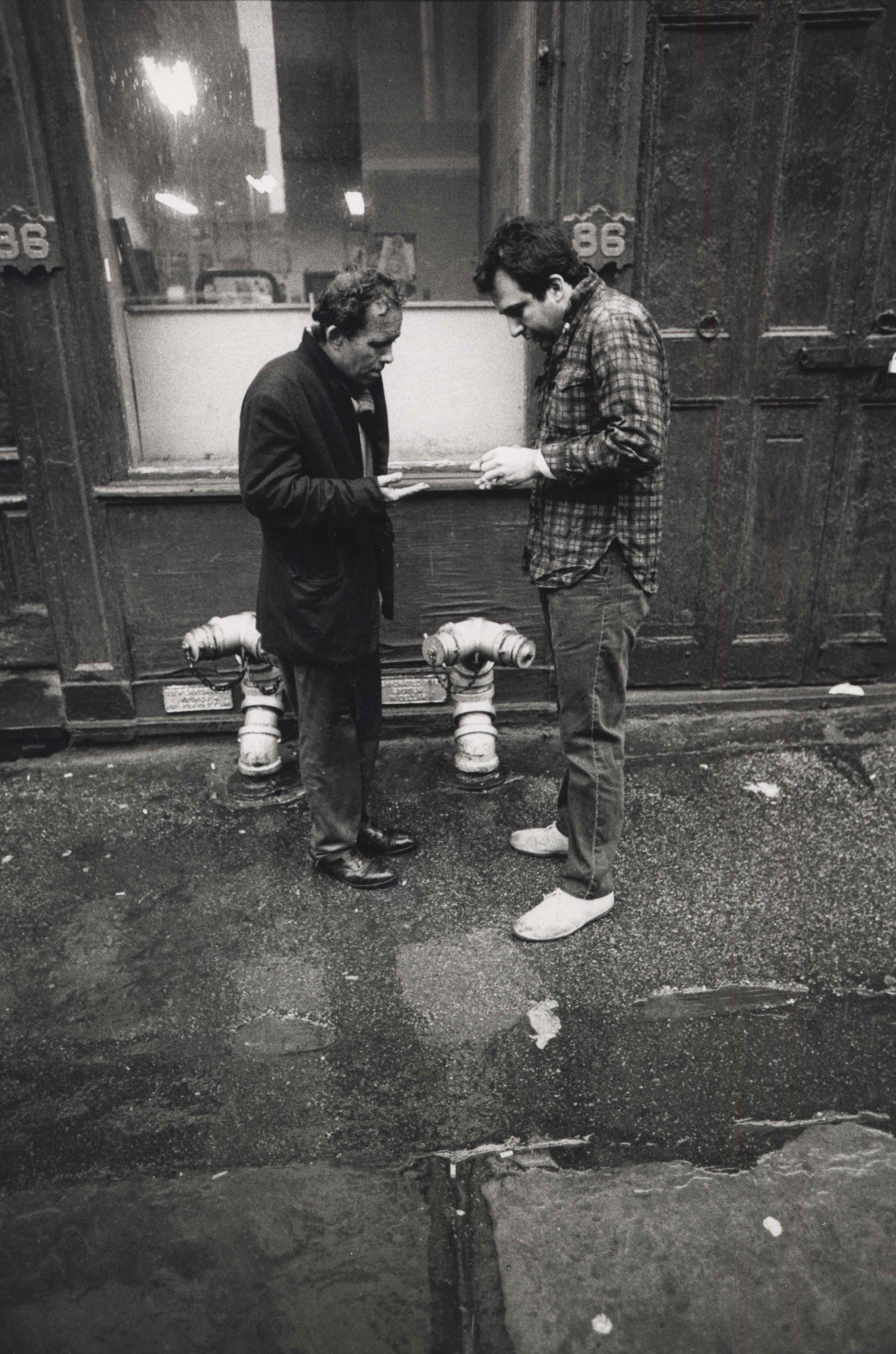 15_110_Two men conversing in front of building 86 _Dan Wynn Archive.jpeg