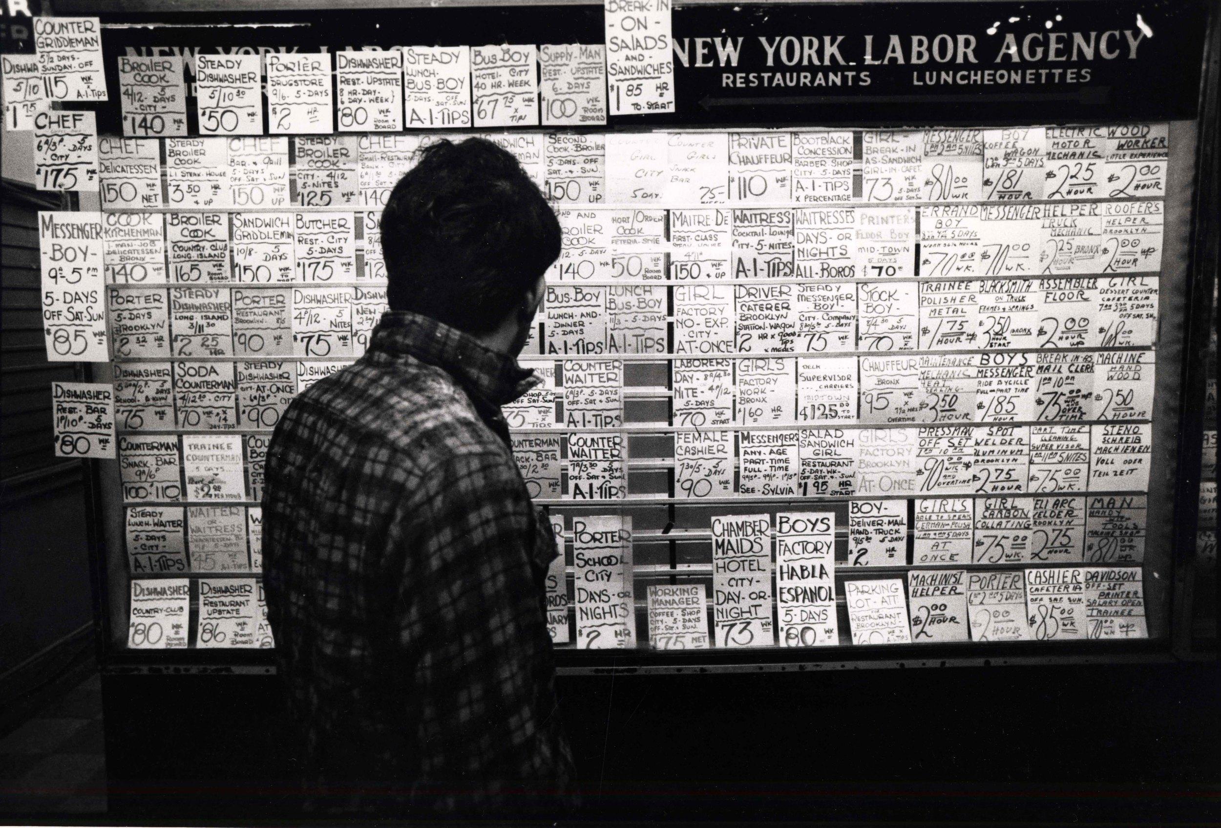 15_113_Man looking at hiring advertisements_Dan Wynn Archive.jpeg