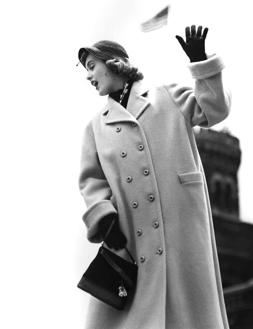 13_53_Model wearing long coat, waving_Dan Wynn Archive.jpg