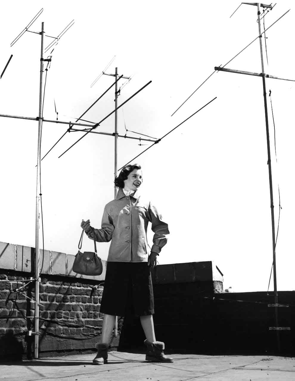 13_54_Model posing on a roof with antennas in the background_Dan Wynn Archive.jpg