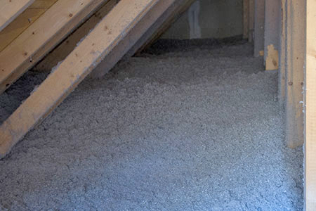 Cellulose insulation in an attic.