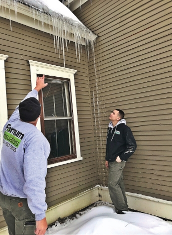 chad-farnum-of-farnum-insulators-talks-about-icicle-buildup-on-local-brattleboro-vt-home.jpg
