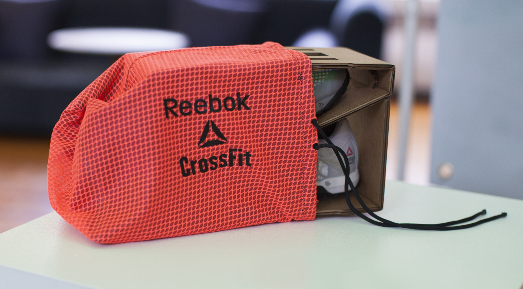 The Rebox concept reduces cardboard use in shoe packaging by 70% while upcycling offcut textile waste.