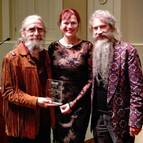 ISTA founder Mandala Cromwell presenting the award to Flournoy and Jose at their 10 Anniversary Conference.