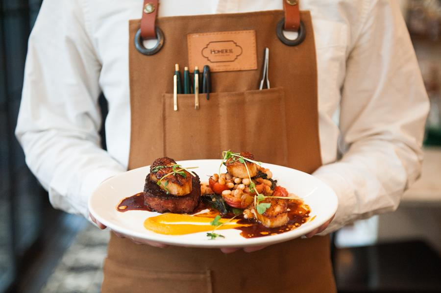 New main dish of Scallops and Pork and Beer Sausage with carrot and cannellini beans. Photo by Milk Creative Communications.