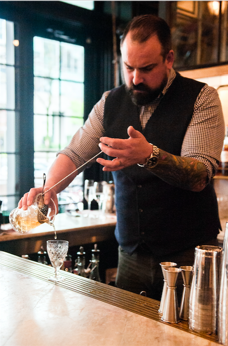 Beverage Director JS Dupuis mixes a cocktail at the Homer Street bar.  Photo by Milk Creative Communications
