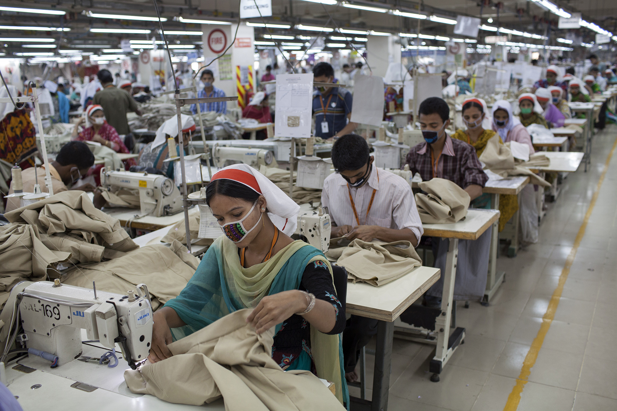 Garment workers on a sewing line at the Sparrow Apparels Limited garment factory in the Gazipur area of Dhaka, Bangladesh. (Credit: Will Baxter)