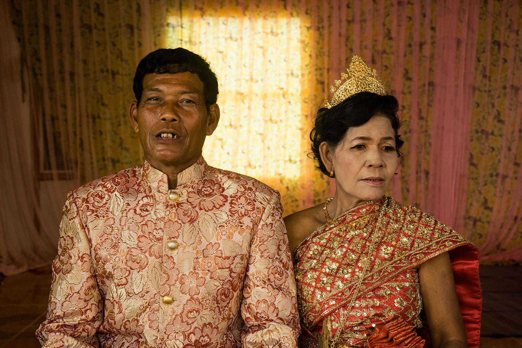 Morb Heang and Nou Sout pose on the day they renewed their vows. (Credit: Hannah Reyes)