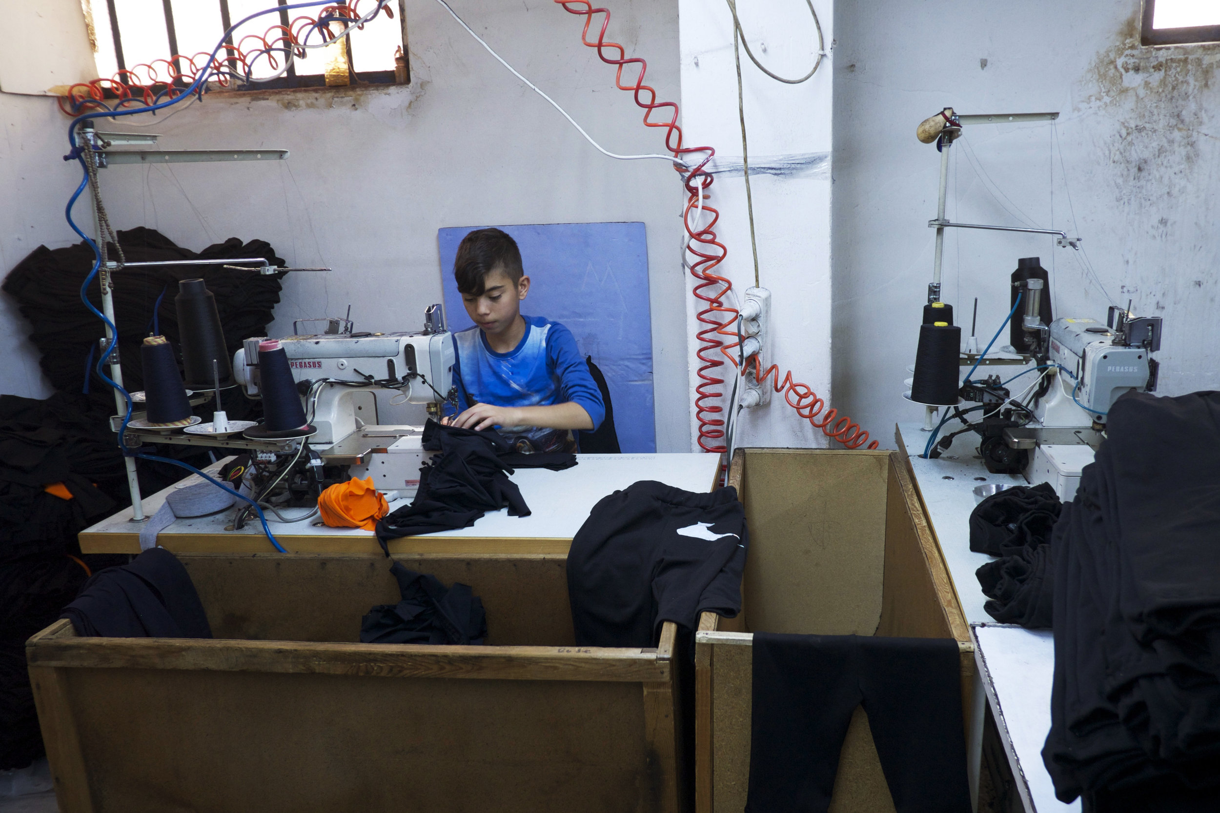 Up to 500,000 Syrian refugees are estimated to be working in Turkey's textile industry, and many of them are children. (Credit: Dene-Hern Chen)