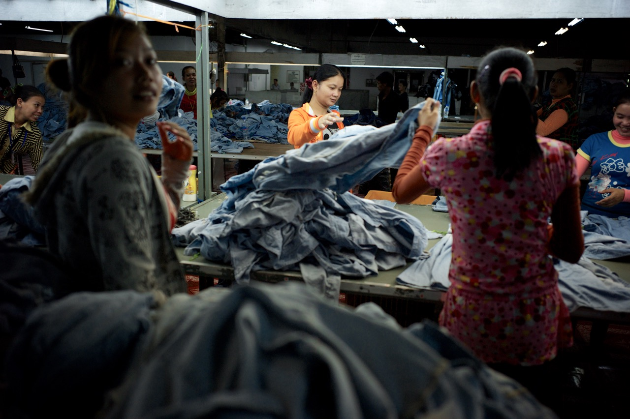 Workers sort clothing in a factory in Cambodia. (Credit: Ben Woods)