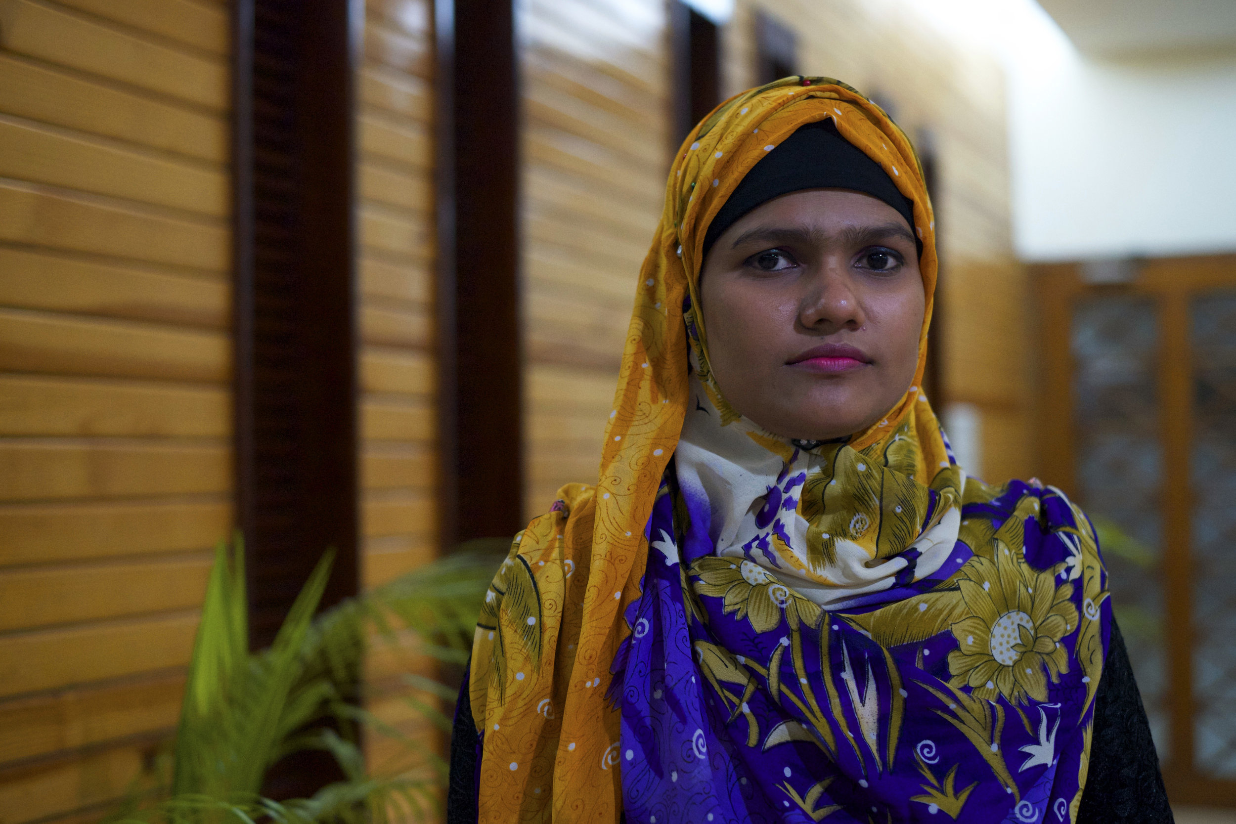 Jasmine Khatum, 21, is a Rohingya woman working in a garment factory in Chittagong as a thread cutter. She and her family fled persecution in Myanmar in 2012, after one of their relatives was beaten to death. (Credit: Dene-Hern Chen
