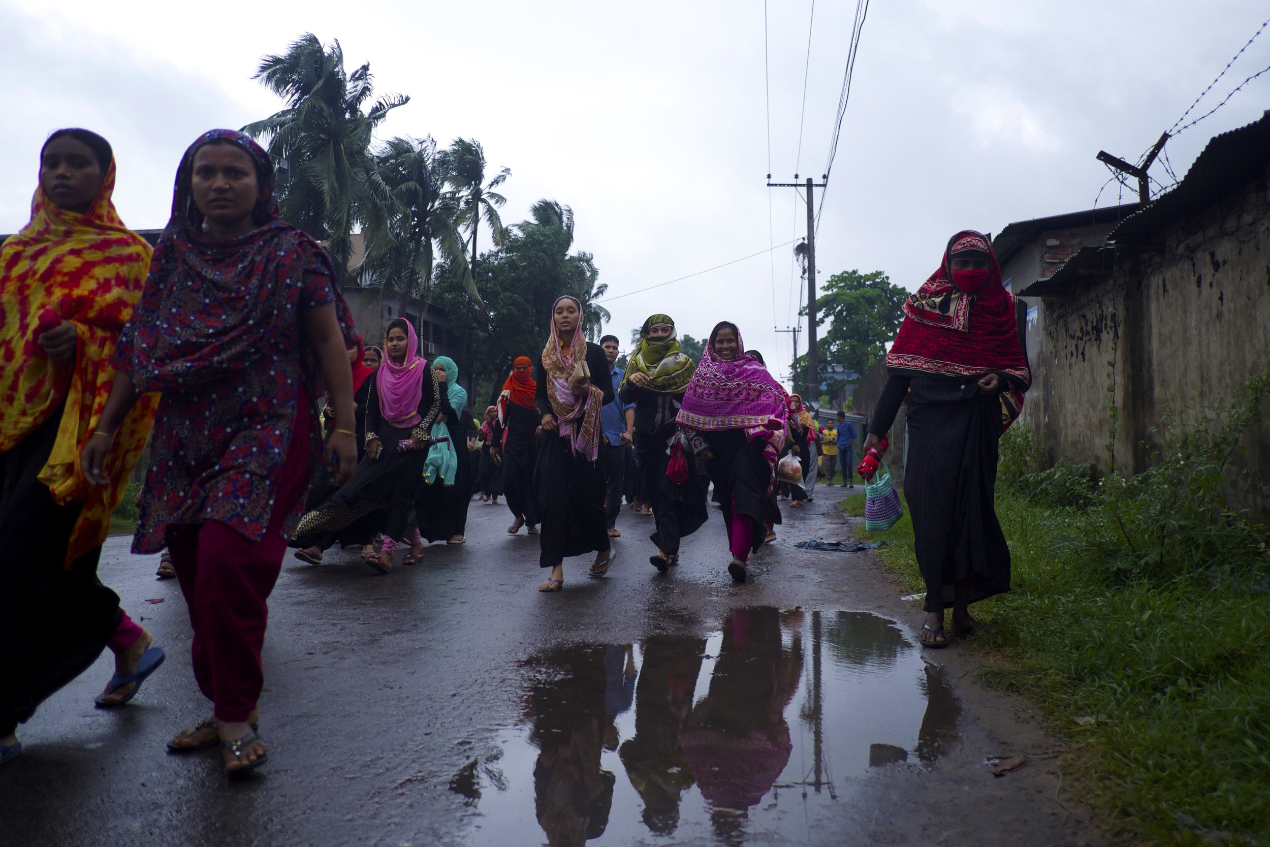 Garment workers in Chittagong, southern Bangladesh, leave their factories at the end of the day. (Credit: Dene-Hern Chen)