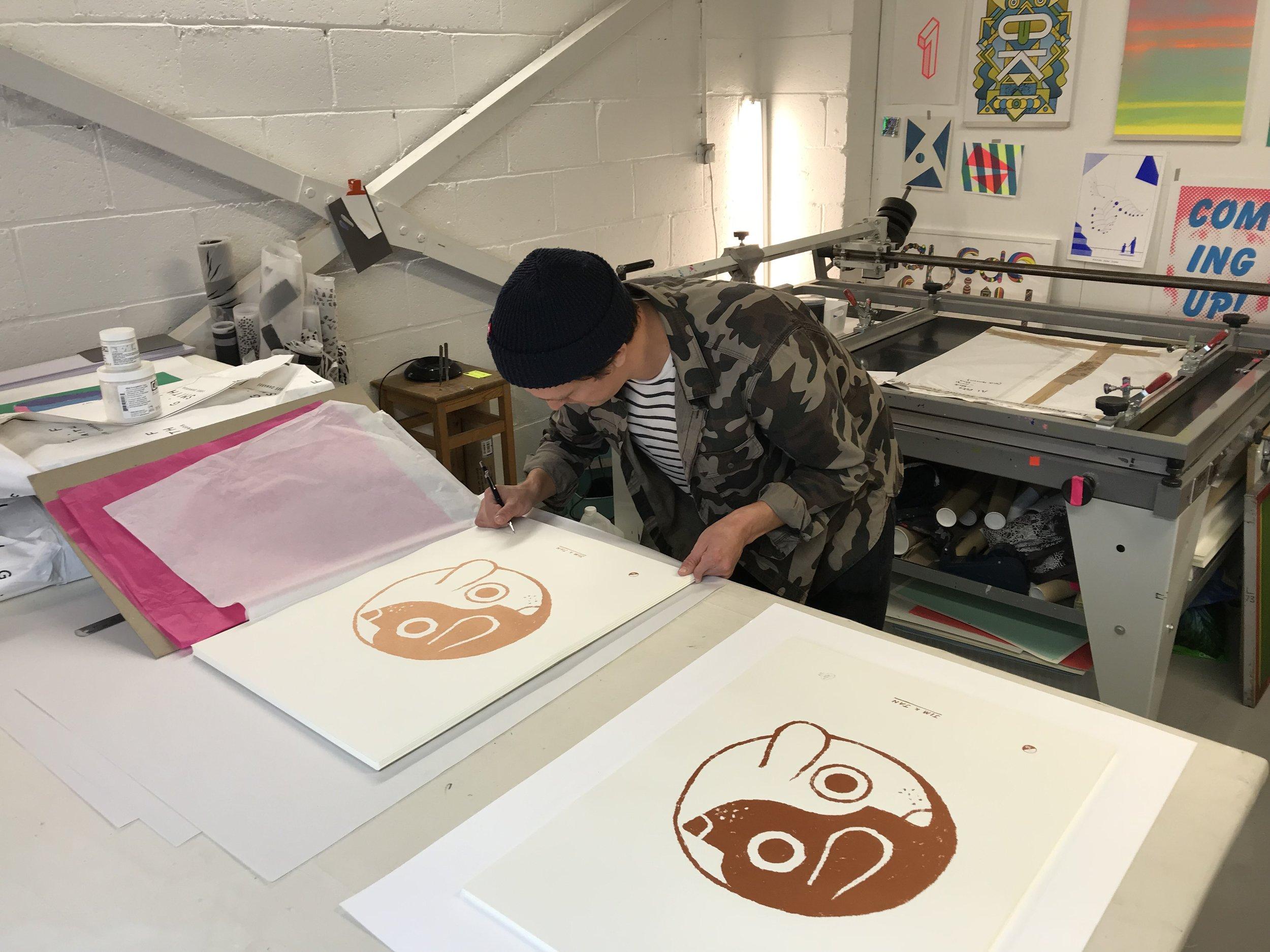 John signing the prints