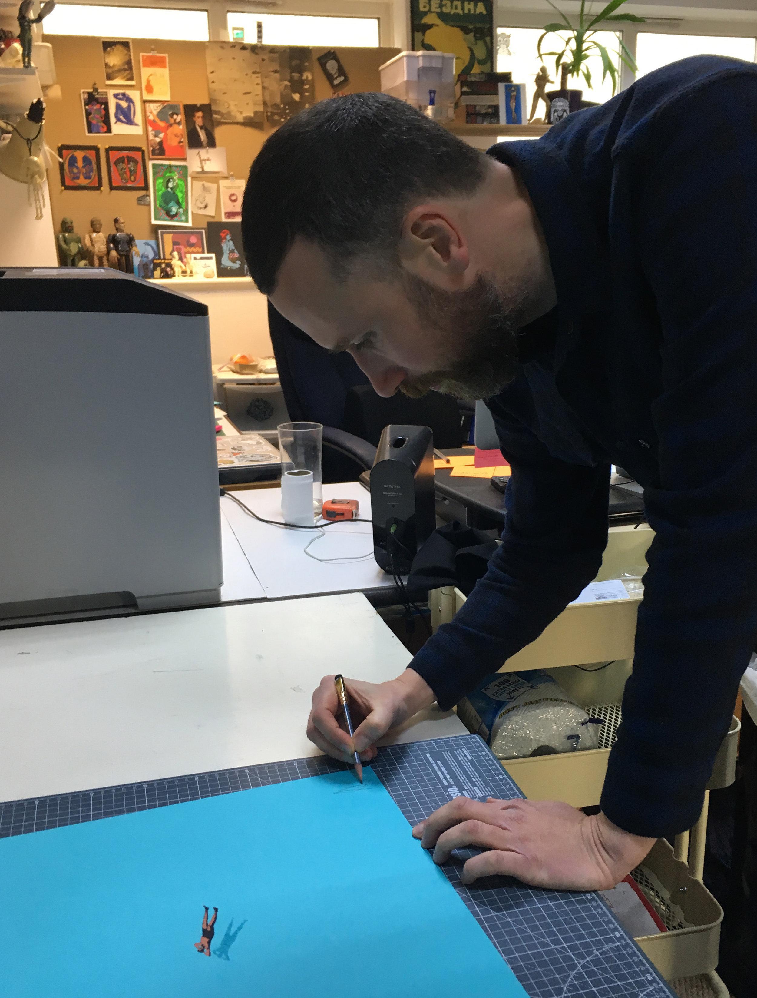Eelus signing the prints in his Brighton studio
