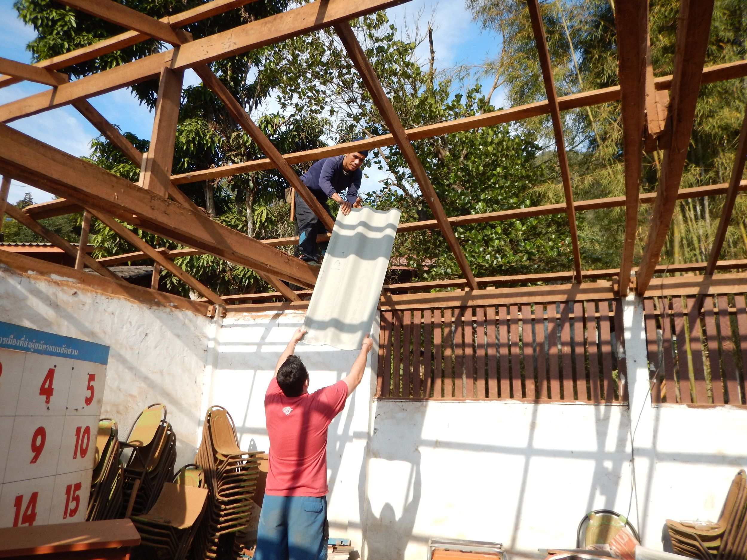 Ryan on site, helping government engineers put up the roof at our school project.