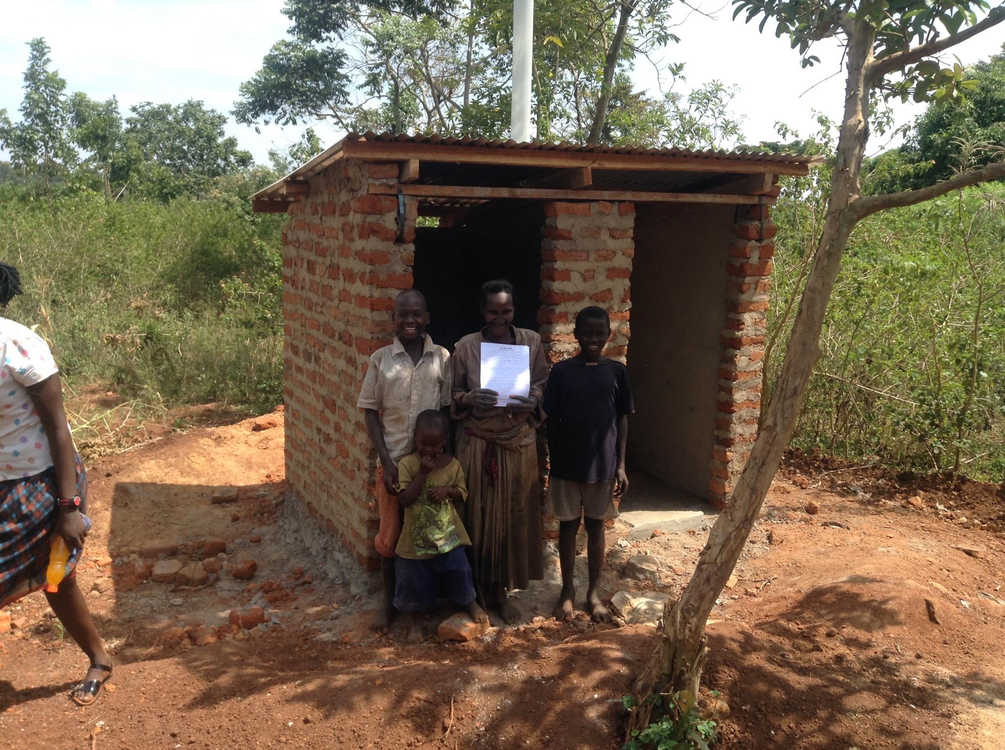 14 Patricia Namulansi finished home & latrine (doors & shutters not hung yet) IMG_0093.jpg