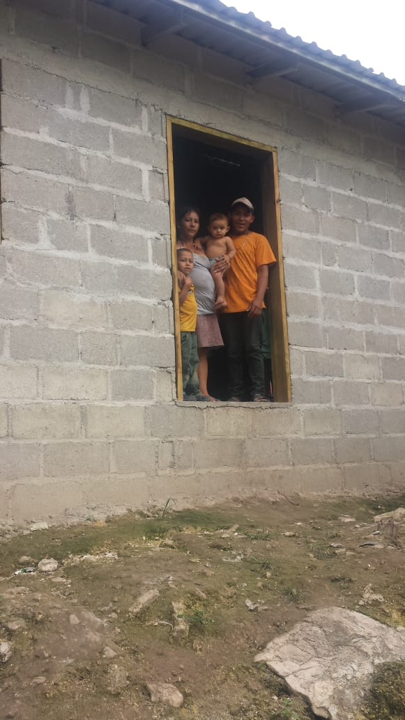 Selvin and Reina have 3 children: Heidy, Rosario and Yovany. Selvin is a farmer on the community plantation and works very hard to care for his family. He is so thankful to receive this home with a concrete floor and solid roof!