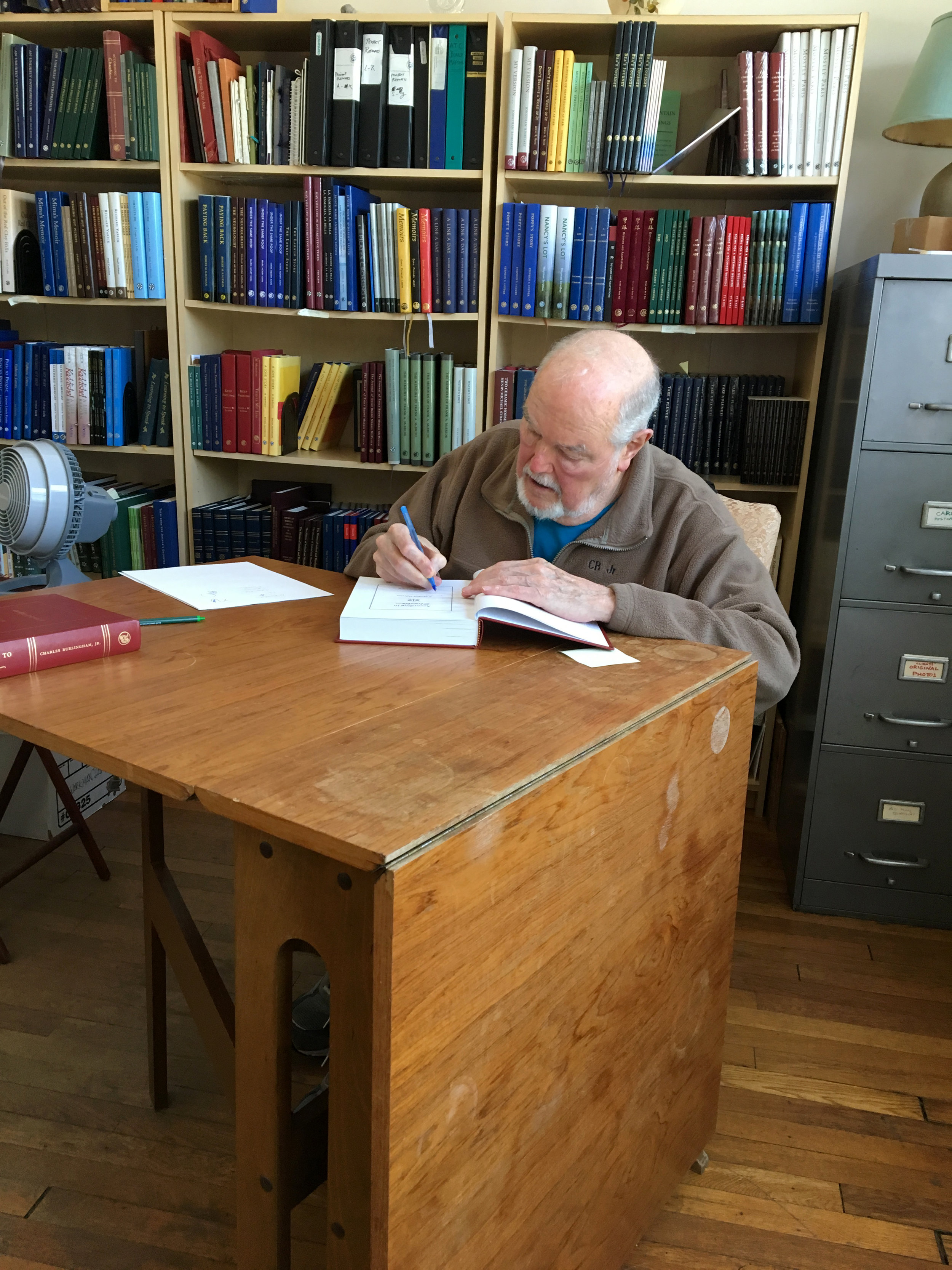 Author Charlie Burlingham inscribes our copies of his memoir  According to Charlie: A Modest Odyssey