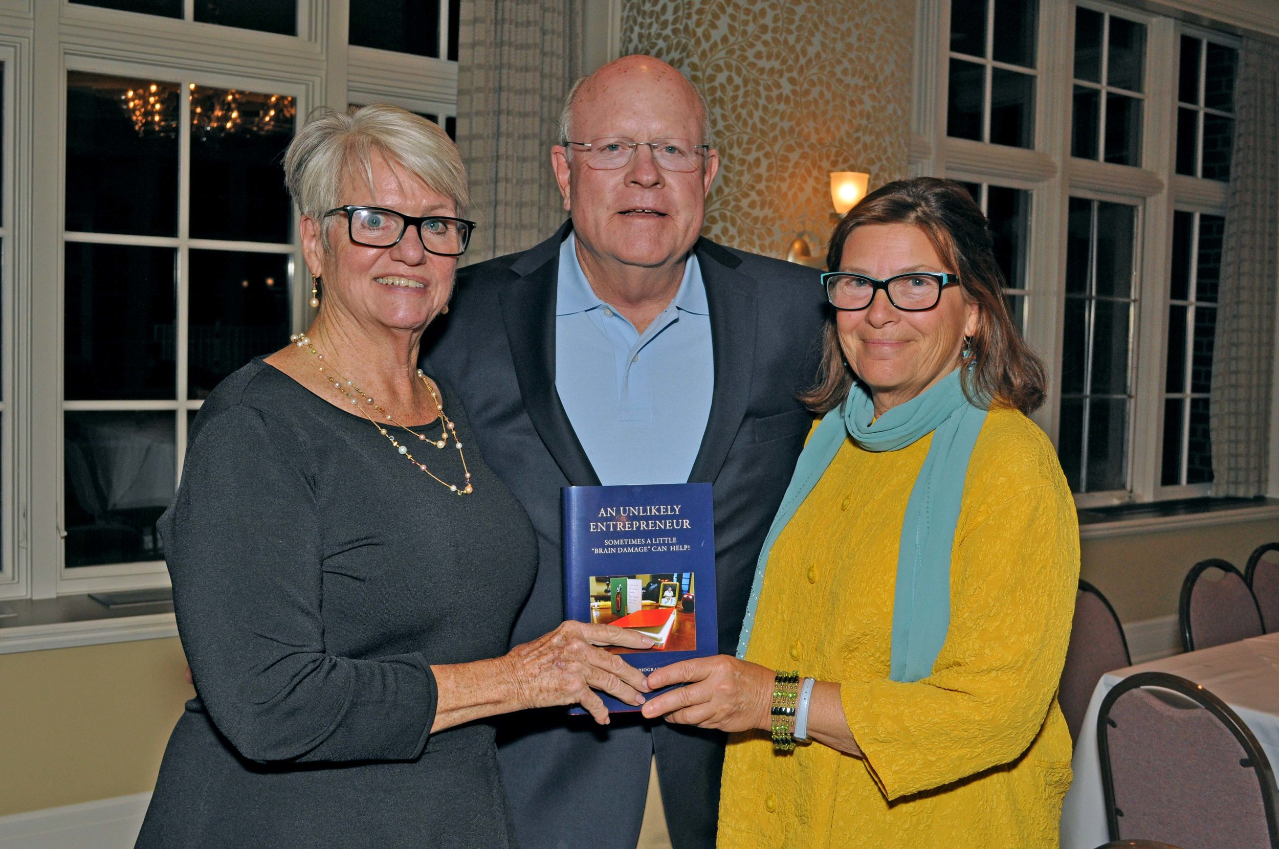 Former clients Mary Jane and John Bower with Kitty (right) celebrating John's completed memoir.