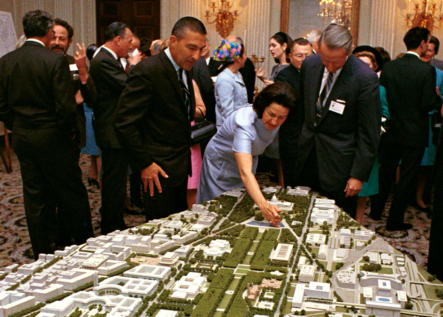 Foreground L-R: Sec. Stewart Udall, Lady Bird Johnson and Laurance Rockefeller look at an architectural model of the Washington, D.C. in 1967.LBJ Library photo by Robert Knudsen.